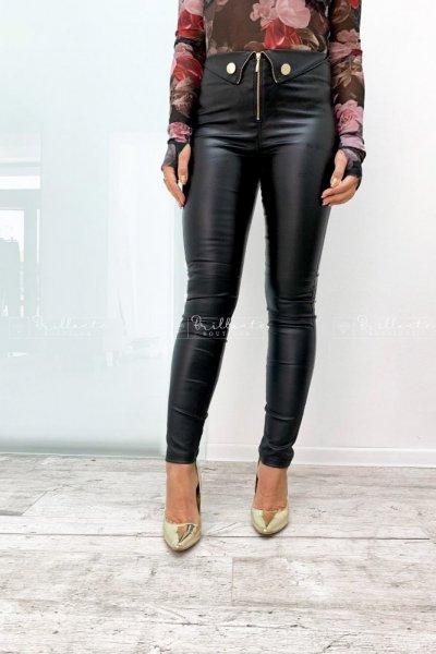 Woskowane spodnie z mankietami