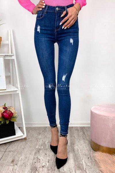 Jeansowe spodnie push-up z przetarciami i wyższym stanem